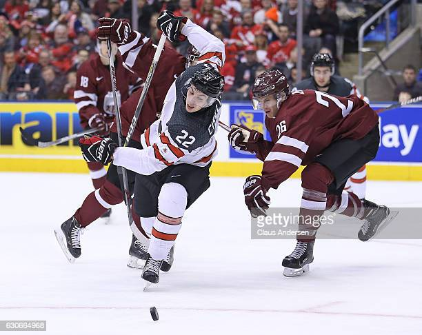 Anthony Cirelli of Team Canada skates past Rimants Zeilis of Team Latvia during a preliminary game in the 2017 IIHF World Junior Hockey Championships...