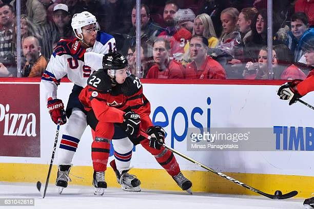 Anthony Cirelli of Team Canada skates the puck against Jordan Greenway of Team United States during the 2017 IIHF World Junior Championship gold...