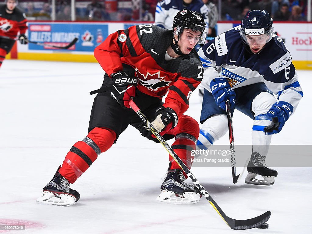 Anthony Cirelli #22 of Team Canada skates the puck against Juho Rautanen of Team Finland #6 during the IIHF exhibition game at the Bell Centre on December 19, 2016 in Montreal, Quebec, Canada. Team Canada defeated Team Finland 5-0.