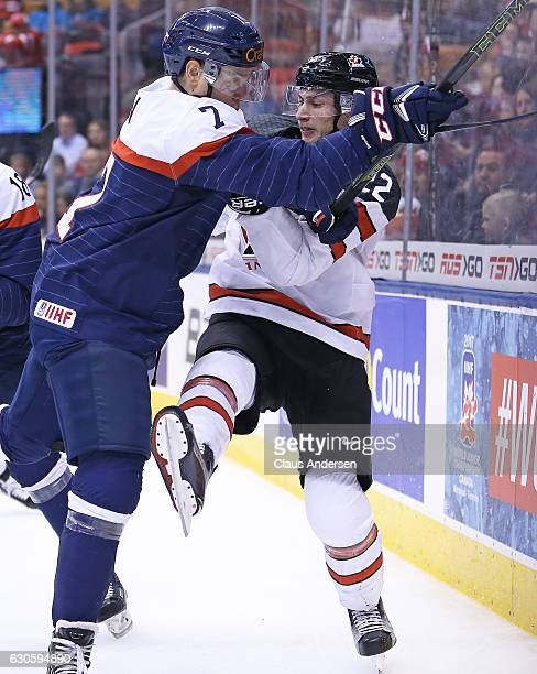 Anthony Cirelli of Team Canada takes a hit from Samuel Hain of Team Slovakia during a preliminary game in the 2017 IIHF World Junior Hockey...