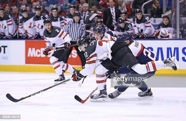 Anthony Cirelli of Team Canada tries to control a puck against Team Slovakia during a preliminary game in the 2017 IIHF World Junior Hockey...