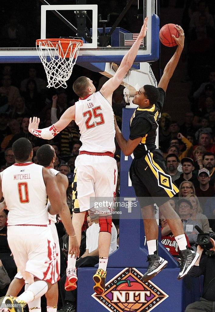 Anthony Clemmens #5 of the Iowa Hawkeyes dunks over a defending Alex Len #25 of the Maryland Terapins in the first half during the 2013 NIT Championship - Semifinals at the Madison Square Garden on April 2, 2013 in New York City.