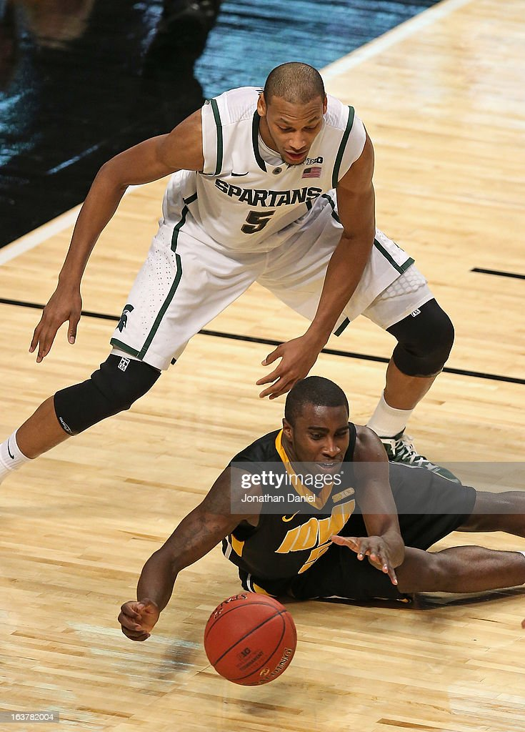 Anthony Clemmens #5 of the Iowa Hawkeyes looses the ball under pressure from Adreian Payne #5 of the Michigan State Spartans during a quarterfinal game of the Big Ten Basketball Tournament at the United Center on March 15, 2013 in Chicago, Illinois. Michigan State defeats Iowa 59-56.