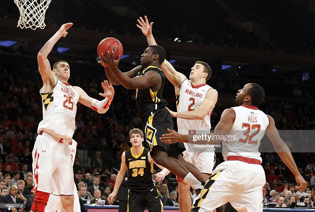 Anthony Clemmens #5 of the Iowa Hawkeyes puts up a shot past Alex Len #25, Logan Aronhalt #2 and Dez Wells #32 of the Maryland Terapins in the second half during the 2013 NIT Championship - Semifinals at the Madison Square Garden on April 2, 2013 in New York City.