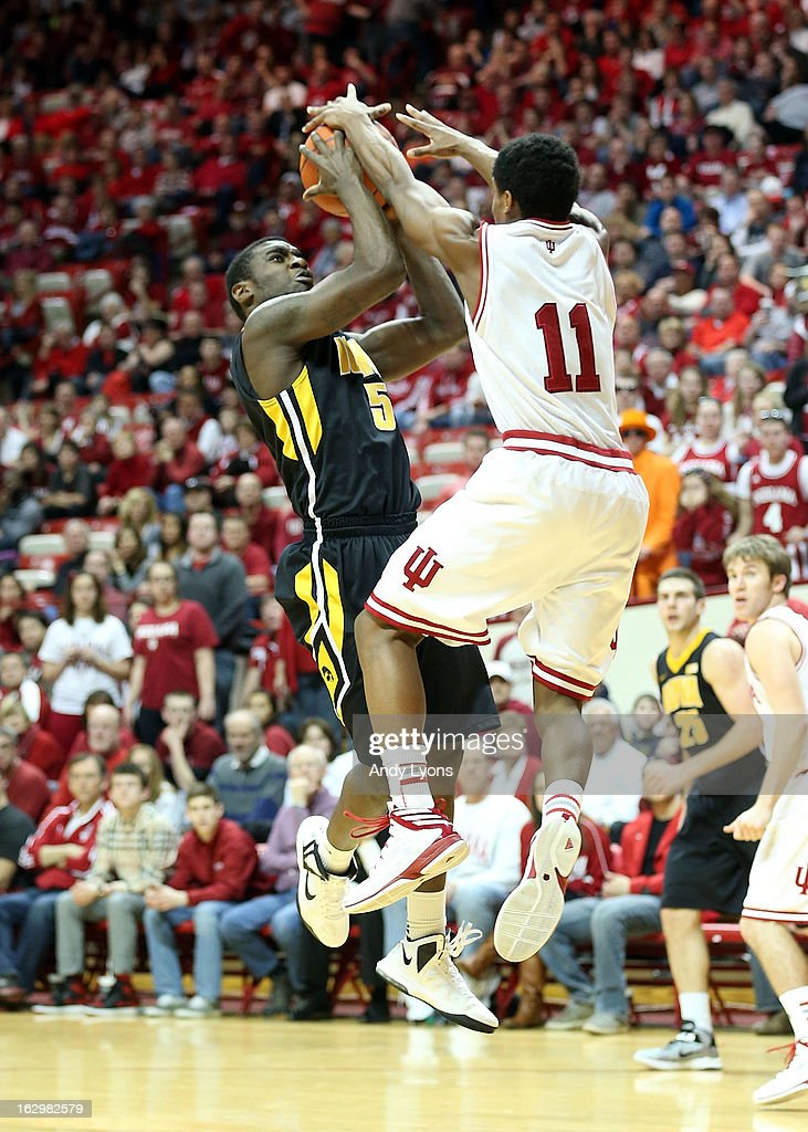 Anthony Clemmons #5 of the Iowa Hawkeyes shoots the ball while defended by Yogi Ferrell #11 of the Indiana Hoosiers during the game at Assembly Hall on March 2, 2013 in Bloomington, Indiana.