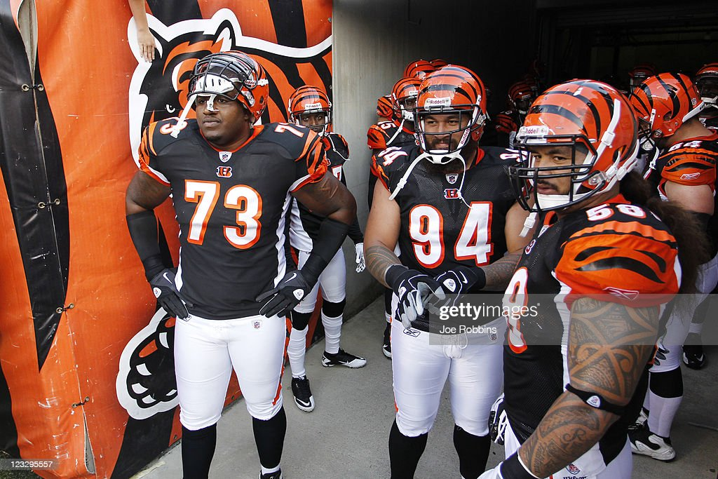 Anthony Collins #73, Domata Peko #94 and Rey Maualuga #58 of the Cincinnati Bengals get set to lead the team onto the field before an NFL preseason game against the Indianapolis Colts at Paul Brown Stadium on September 1, 2011 in Cincinnati, Ohio. The Colts won 17-13.