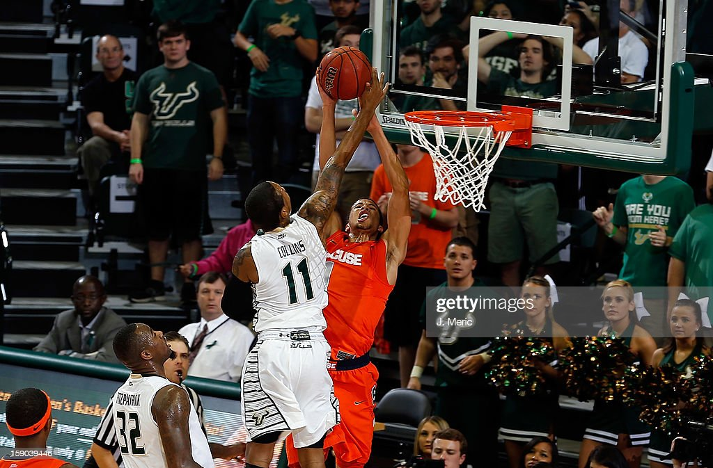 Anthony Collins #11 of the South Florida Bulls blocks the shot of <a gi-track='captionPersonalityLinkClicked' href=/galleries/search?phrase=Michael+Carter-Williams&family=editorial&specificpeople=7621167 ng-click='$event.stopPropagation()'>Michael Carter-Williams</a> #1 of the Syracuse Orange during the game at the Sun Dome on January 6, 2013 in Tampa, Florida.