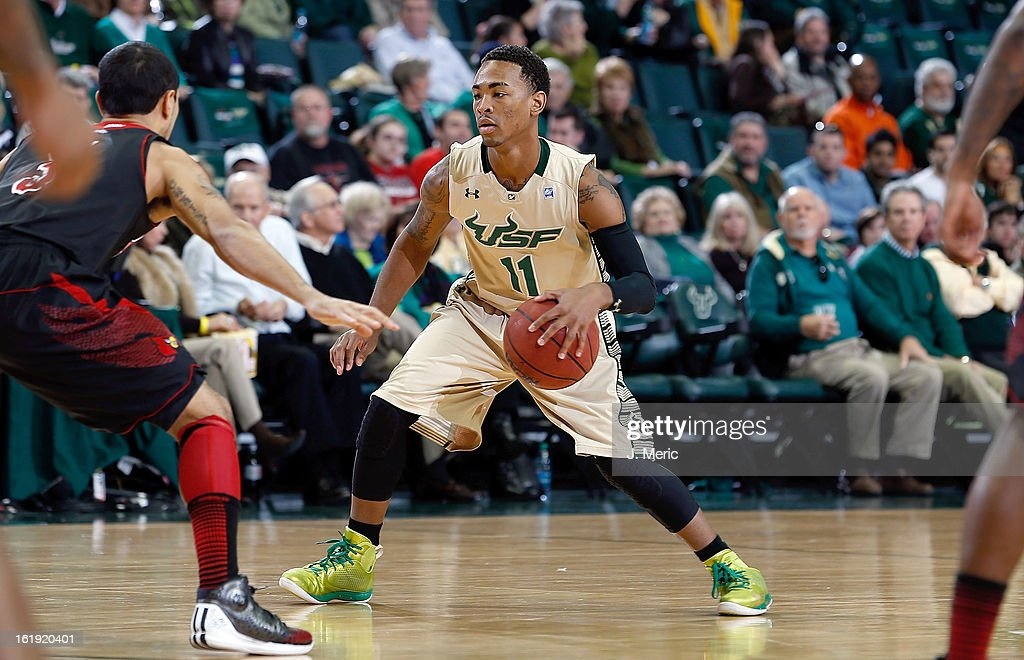Anthony Collins #11 of the South Florida Bulls brings the ball up the court against the Louisville Cardinals during the game at the Sun Dome on February 17, 2013 in Tampa, Florida.