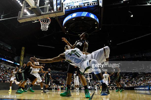 Anthony Collins of the South Florida Bulls draws a foul against Walter Offutt of the Ohio Bobcats during the third round of the 2012 NCAA Men's...