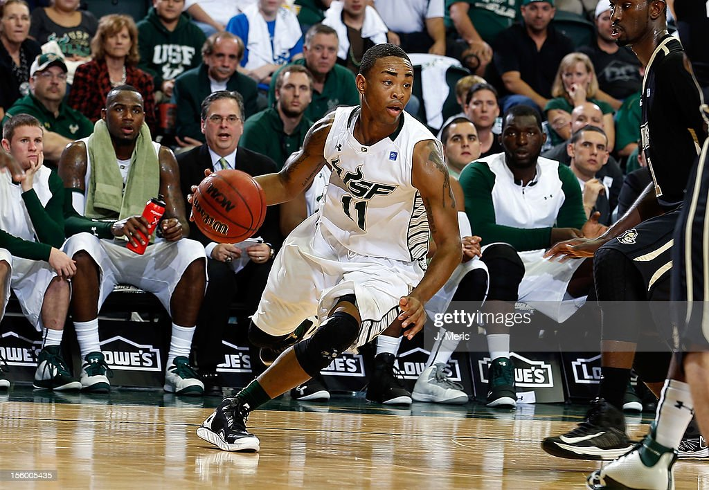 Anthony Collins #11 of the South Florida Bulls drives against the Central Florida Knights during the game at the Sun Dome on November 10, 2012 in Tampa, Florida.