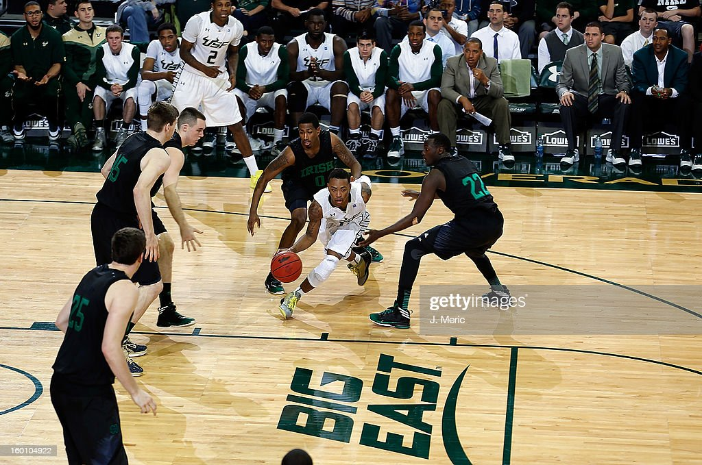 Anthony Collins #11 of the South Florida Bulls drives against the Notre Dame Fighting Irish during the game at the Sun Dome on January 26, 2013 in Tampa, Florida.