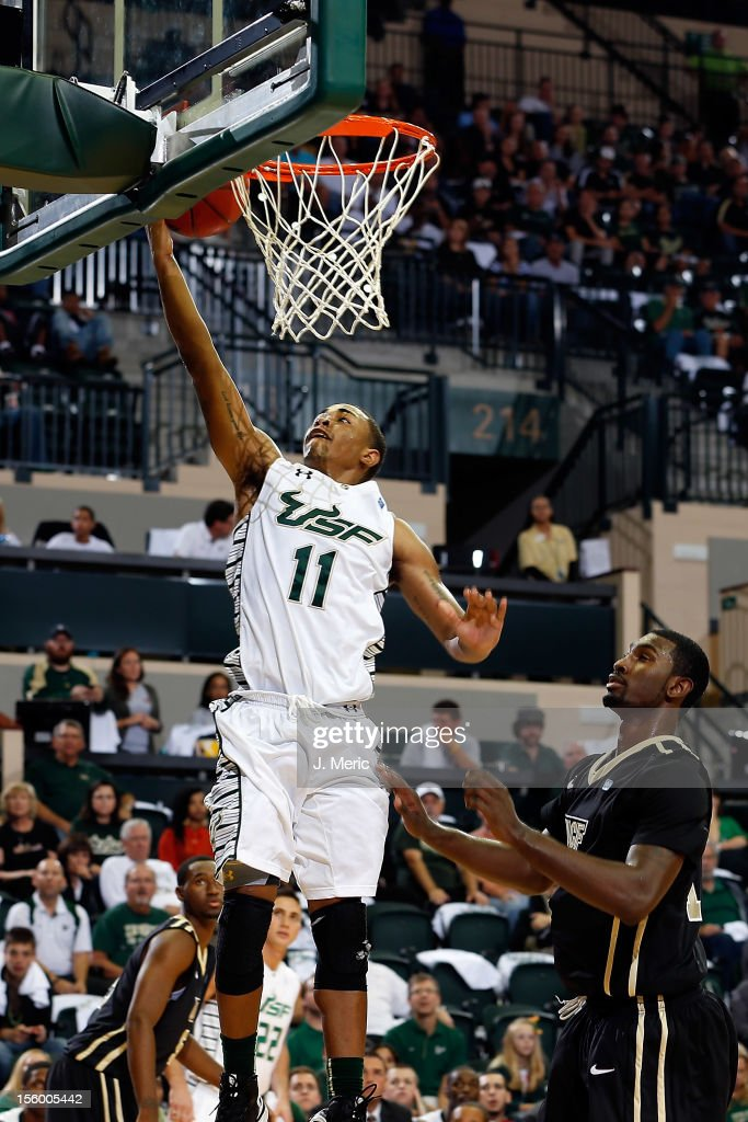 Anthony Collins #11 of the South Florida Bulls drives to the basket against the Central Florida Knights during the game at the Sun Dome on November 10, 2012 in Tampa, Florida.