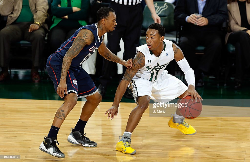 Anthony Collins #11 of the South Florida Bulls handles the ball against Ryan Boatright #11 of the Connecticut Huskies during the game at the Sun Dome on March 6, 2013 in Tampa, Florida.