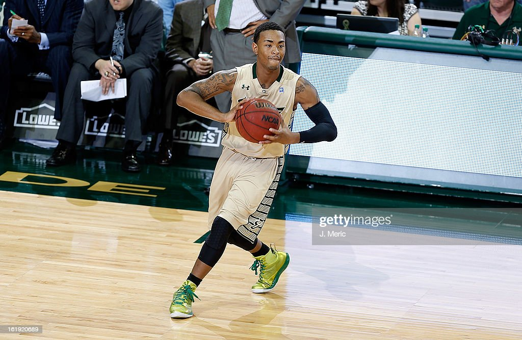Anthony Collins #11 of the South Florida Bulls passes the ball against the Louisville Cardinals during the game at the Sun Dome on February 17, 2013 in Tampa, Florida.