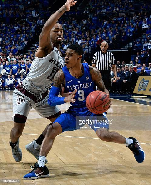Anthony Collins of the Texas AM Aggies defends Tyler Ulis of the Kentucky Wildcats during the first half of the SEC Basketball Tournament...