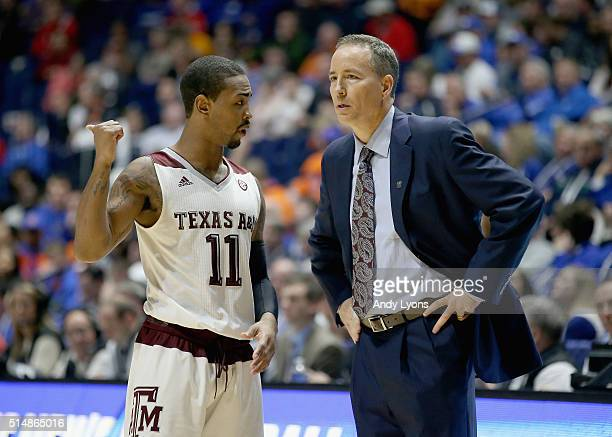 Anthony Collins of the Texas AM Aggies talks to Billy Kennedy the head coach in the game against the Florida Gators during the quarterfinals of the...