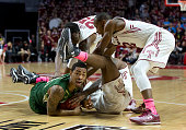 Anthony Collins of the USF Bulls wrestles for the ball with Jaylen Bond Quenton DeCosey and Will Cummings of the Temple Owls on January 22 2015 at...