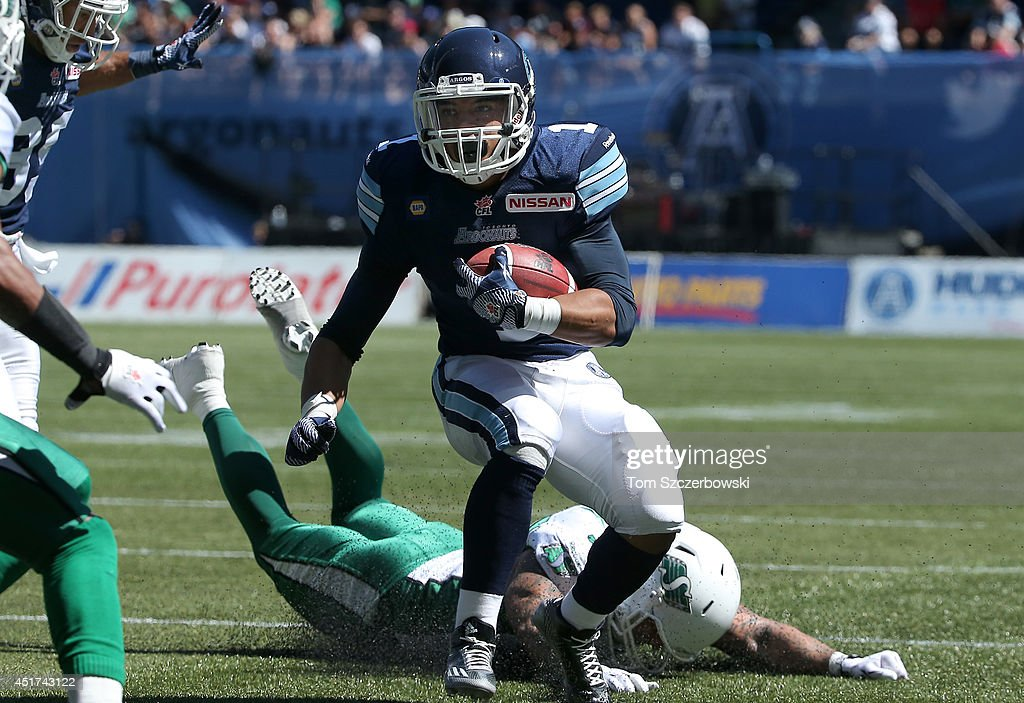Anthony Coombs #1 of the Toronto Argonauts breaks a tackle and keeps running with the ball during a CFL game against the Saskatchewan Roughriders on July 5, 2014 at Rogers Centre in Toronto, Ontario, Canada.