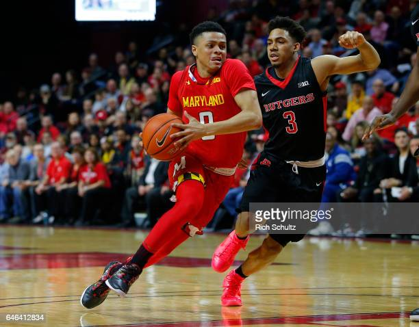 Anthony Cowan of the Maryland Terrapins drives to the basket as Corey Sanders of the Rutgers Scarlet Knights defends during the first half of an NCAA...