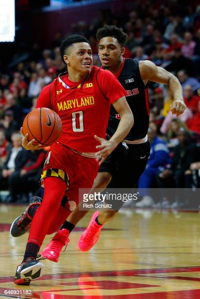 Anthony Cowan of the Maryland Terrapins in action against Corey Sanders of the Rutgers Scarlet Knights during an NCAA college basketball game at...