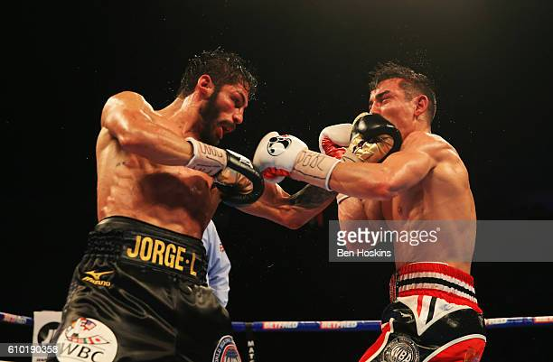 Anthony Crolla and Jorge Linares in action during the contest for WBA WBC Diamond and Ring Magazine Lightweight World Titles at Manchester Arena on...