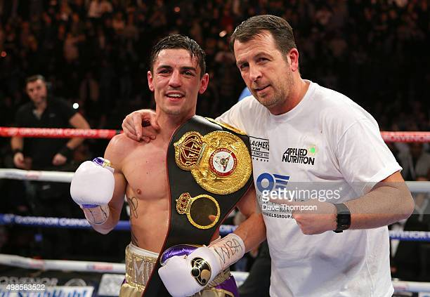 Anthony Crolla and trainer Joe Gallagher after beating Darleys Perez during their WBA World Lightweight Championship bout at the Manchester Arena on...