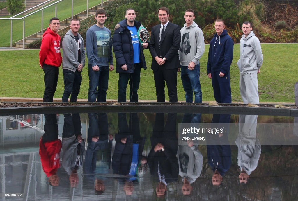 Anthony Crolla, Callum Smith, Tony Bellew, Eddie Hearn, Scotty Cardle, Tom Stalker and Derry Matthews pose for a group photograph outside the Hilton Hotel after a press conference to promote Betfairs's 'No Retreat, No Surrender' event on January 9, 2013 in Liverpool, England.