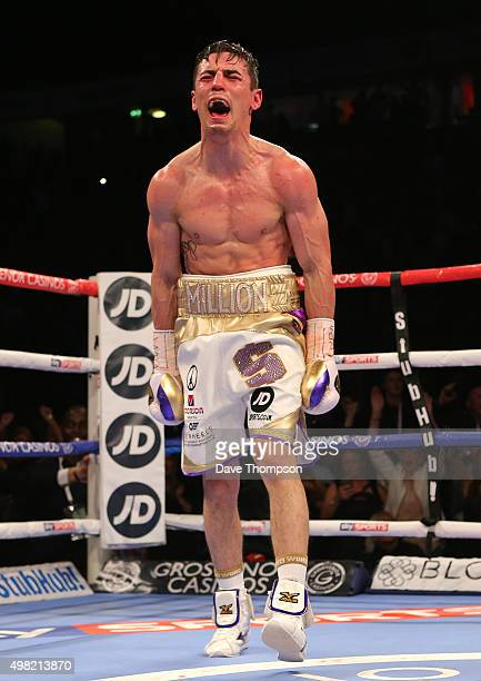 Anthony Crolla celebrates as Darleys Perez fails to beat the referee's ten count during their WBA World Lightweight Championship bout at the...