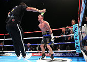 Anthony Crolla celebrates beating Ismael Barroso as his trainer Joe Gallagher jumps in the ring to congratulate him on winning the WBA World...