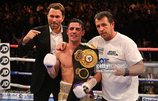 Anthony Crolla celebrates with promoter Eddie Hearn and trainer Joe Gallagher right after beating Darleys Perez during their WBA World Lightweight...