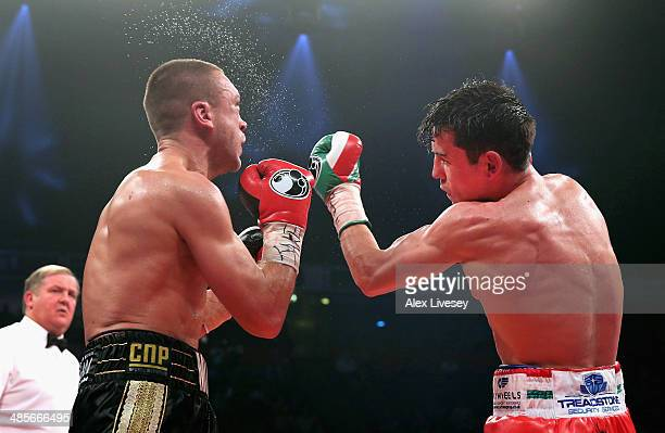 Anthony Crolla lands a left hook on John Murray during the WBO InterContinental Lightweight Title fight between Anthony Crolla John Murray at the...