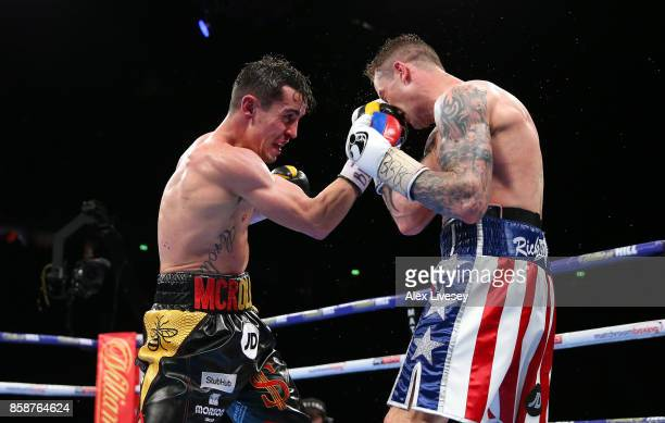 Anthony Crolla lands a right shot on Ricky Burns during the Lightweight contest at Manchester Arena on October 7 2017 in Manchester England