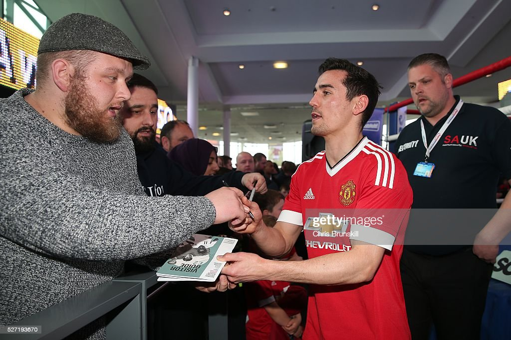Anthony Crolla signs autographs during a media work out at the National Football Museum on May 02, 2016 in Manchester, England.