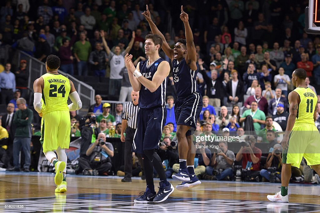 Anthony Dallier and Brandon Sherrod of the Yale Bulldogs celebrate following their 7975 victory against the Baylor Bears during the first round of...