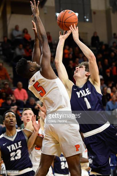 Anthony Dallier of the Yale Bulldogs shoots the ball against Amir Bell of the Princeton Tigers during the first half of the Ivy League tournament...