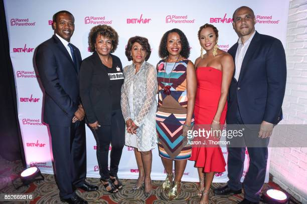 Anthony Daniels Dr Joia CrearPerry Congresswoman Maxine Waters Fashion Designer Tracy Reese Singer Letoya Luckett and Senator Cory Booker pose at the...