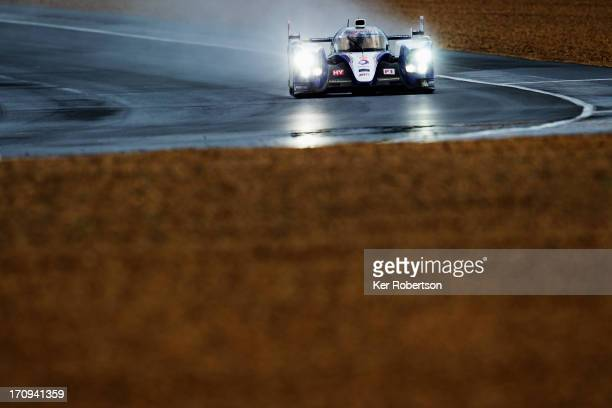 Anthony Davidson of Great Britain drives the Toyota Racing TS030 Hybrid during qualifying for the Le Mans 24 Hour race at the Circuit de la Sarthe on...
