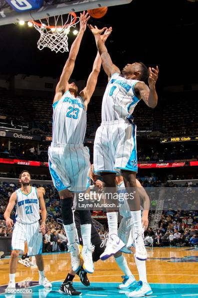 Anthony Davis and AlFarouq Aminu of the New Orleans Hornets reach for a rebound against the San Antonio Spurs on January 7 2013 at the New Orleans...