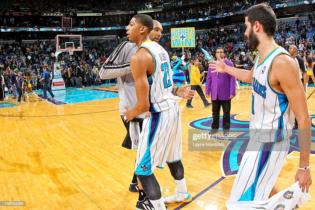 Anthony Davis #23 and Greivis Vasquez #21 of the New Orleans Hornets greet Tim Duncan #21 of the San Antonio Spurs following their game on January 7, 2013 at the New Orleans Arena in New Orleans, Louisiana.
