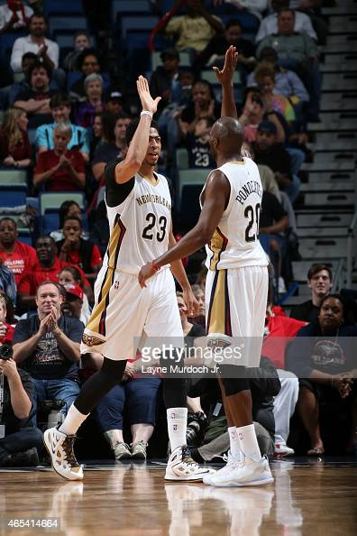 Anthony Davis and Quincy Pondexter of the New Orleans Pelicans celebrate during a game against the Detroit Pistons on March 4 2015 at Smoothie King...