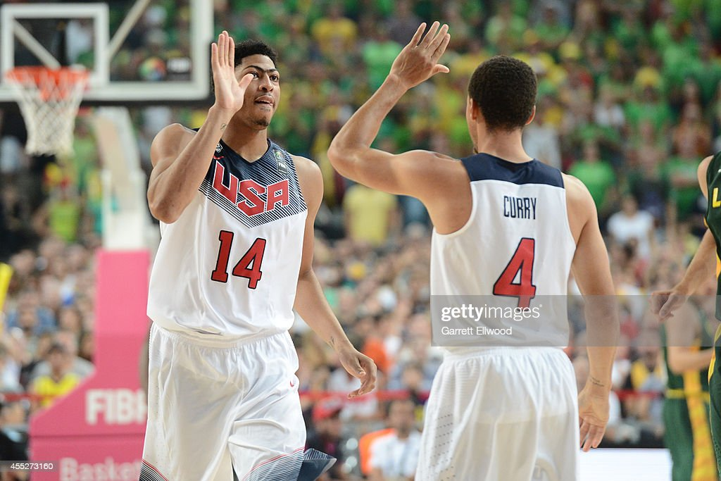 Anthony Davis high fives Stephen Curry of the USA Basketball Men's National Team in the game against the Lithuania National Team during the 2014 FIBA...
