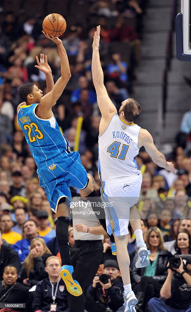 Anthony Davis of New Orleans Hornets #23 jumps for the basket over Kosta Koufos of Denver Nuggets #41 in the 2nd half of the game on February 1, 2013 at Pepsi Center in Denver, Colorado. Denver won 113-98.