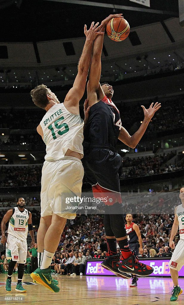Anthony Davis #14 of team USA rebounds over <a gi-track='captionPersonalityLinkClicked' href=/galleries/search?phrase=Tiago+Splitter&family=editorial&specificpeople=208218 ng-click='$event.stopPropagation()'>Tiago Splitter</a> #15 of team Brazil during an exhibition game at the United Center on August 16, 2014 in Chicago, Illinois. Team USA defeated team Brazil 95-78.