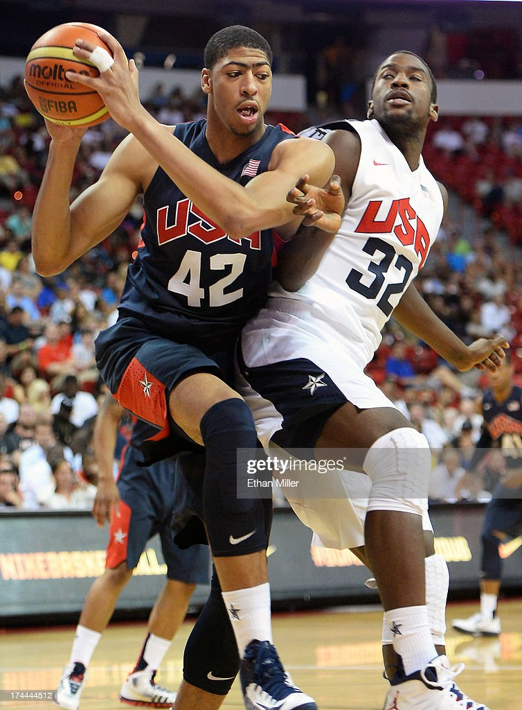 Anthony Davis #42 of the 2013 USA Basketball Men's National Team grabs a loose ball against Michael Kidd-Gilchrist #32 of the 2013 USA Basketball Men's National Team during a USA Basketball showcase at the Thomas & Mack Center on July 25, 2013 in Las Vegas, Nevada.