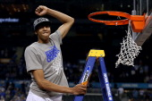 Anthony Davis of the Kentucky Wildcats celebrates before he cuts down the net after the Wildcats defeat the Kansas Jayhawks 6759 in the National...