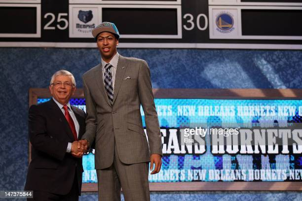 Anthony Davis of the Kentucky Wildcats greets NBA Commissioner David Stern after he was selected number one overall by the New Orleans Hornets during...