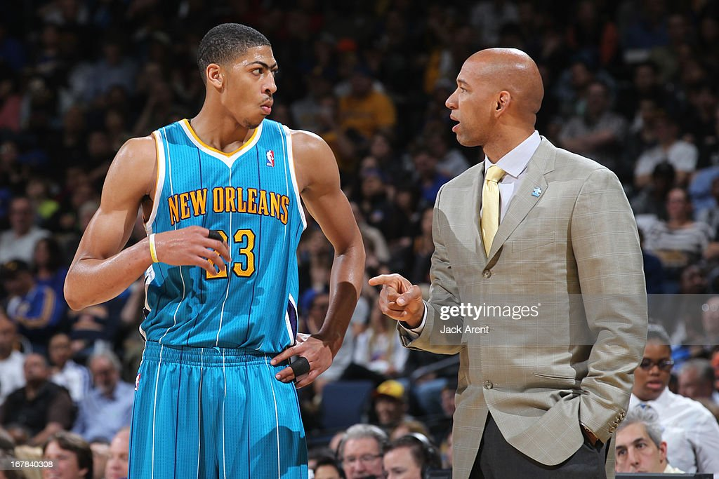 Anthony Davis #23 of the New Orleans Hornets and Fred Vinson talk during the game against the Golden State Warriors on April 3, 2013 at Oracle Arena in Oakland, California.