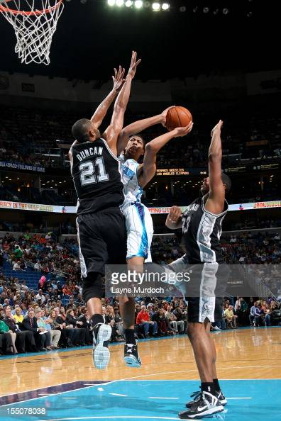 Anthony Davis of the New Orleans Hornets attempts a shot against Tim Duncan of the San Antonio Spurs on October 31 2012 at the New Orleans Arena in...