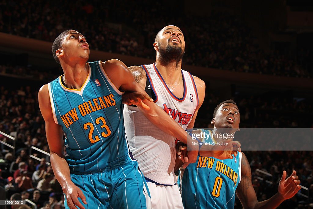 Anthony Davis #23 of the New Orleans Hornets boxes out against <a gi-track='captionPersonalityLinkClicked' href=/galleries/search?phrase=Tyson+Chandler&family=editorial&specificpeople=202061 ng-click='$event.stopPropagation()'>Tyson Chandler</a> #6 of the New York Knicks on January 13, 2013 at Madison Square Garden in New York City.