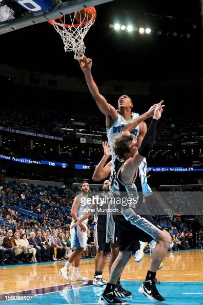 Anthony Davis of the New Orleans Hornets drives to the basket against Tiago Splitter of the San Antonio Spurs on January 7 2013 at the New Orleans...